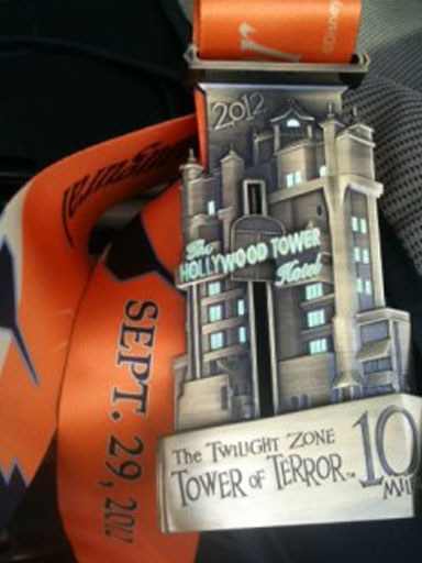 "Inaugural Tower of Terror 10-Miler medal and ribbon from Amanda's celebratory ""I Ran Disney!"" blog postabout the race."